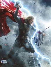"Chris Hemsworth Autographed 8"" x 10"" Thor: Fighting Hand in Air Grey Photograph - Beckett COA"