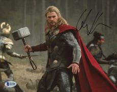 "Chris Hemsworth Autographed 8"" x 10"" Thor: Standing Holding Hammer in Air Photograph - Beckett COA"