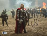 "Chris Hemsworth Autographed 8"" x 10"" Thor: Standing in Battlefield Photograph - Beckett COA"