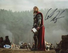 "Chris Hemsworth Autographed 8"" x 10"" Thor- Standing on Rock Holding Thor Hammer Photograph - Beckett COA"