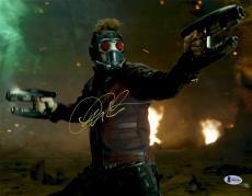 """Chris Pratt Autographed 12"""" x 18"""" Shooting Guns In Both Hands Guardians Of The Galaxy Photograph - Beckett COA"""