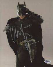 "Christian Bale Autographed 8"" x 10"" The Dark Knight Batman Begins Kneeling with Hand on Head Pose Photograph - Beckett COA"
