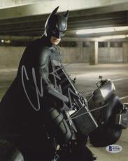 "Christian Bale Autographed 8"" x 10"" The Dark Knight Batman Begins on Motorcycle Pointing Gun Down Photograph - Beckett COA"