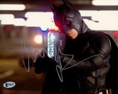 """Christian Bale Autographed 8"""" x 10"""" The Dark Knight Batman Holding Large Bat Gun Photograph - Beckett COA"""