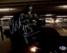 "Christian Bale Autographed 8"" x 10"" The Dark Knight Batman on Motorcycle in Garage Horizontal Photograph - Beckett COA"