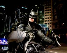 "Christian Bale Autographed 8"" x 10"" The Dark Knight Batman On Motorcycle with City in Background Photograph - Beckett COA"