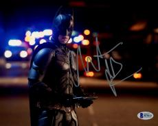 "Christian Bale Autographed 8"" x 10"" The Dark Knight Batman Standing in Street Holding Tablet Horizontal Photograph - Beckett COA"