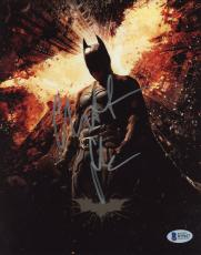 "Christian Bale Autographed 8"" x 10"" The Dark Knight Batman Standing with Buildings Falling & Fire Batman Symbol in Background Photograph - Beckett COA"