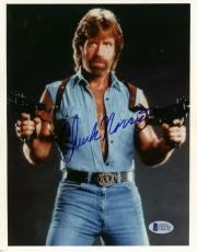 "Chuck Norris Autographed 8""x 10"" Invasion USA Posing With Guns Photograph - Beckett COA"