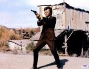 "Clint Eastwood Autographed 11""x 14"" Dirty Harry Holding Gun In Field Photograph - PSA/DNA LOA"