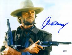 "Clint Eastwood Autographed 11""x 14"" The Outlaw Josey Wales Holding Guns Photograph - BAS LOA"