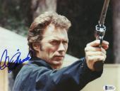 """Clint Eastwood Autographed 8""""x 10"""" Magnum Force Dirt Harry Holding Gun Photograph - Beckett COA"""