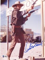 "Clint Eastwood Autographed 8""x 10"" The Outlaw Josey Wales Shooting Guns Photograph - Beckett COA"