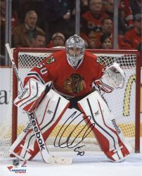 Corey Crawford Chicago Blackhawks Autographed 8'' x 10'' Red Uniform Stance Photograph - Mounted Memories