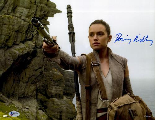 "Daisy Ridley Autographed 11"" x 14"" Star Wars The Force Awakens Holding lightsaber Photograph - Beckett"