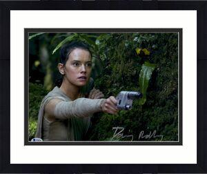 "Daisy Ridley Autographed 11"" x 14"" Star Wars The Force Awakens Holding Silver Blaster Gun Photograph - Beckett"