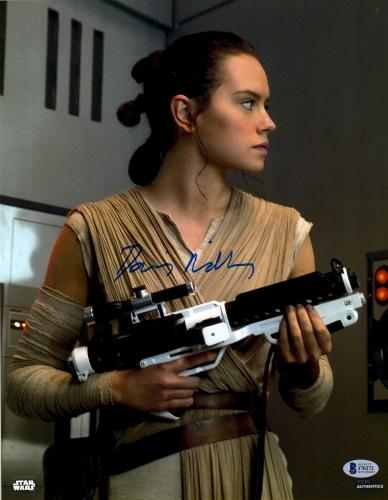 "Daisy Ridley Autographed 11"" x 14"" Star Wars The Force Awakens Holding Storm Trooper Blaster Photograph - Beckett"