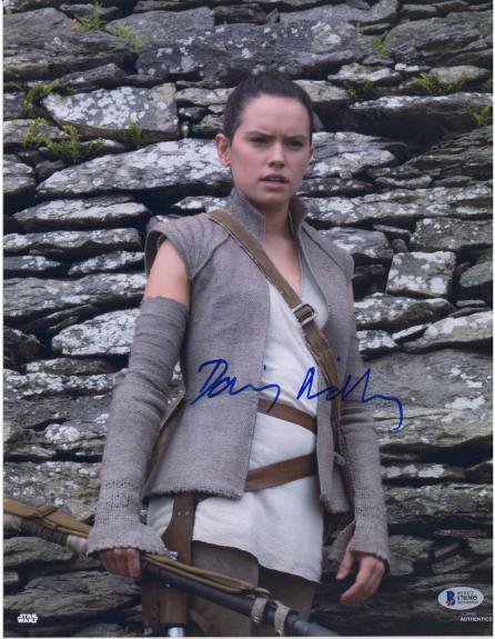"""Daisy Ridley Star Wars Autographed 11"""" x 14"""" The Force Awakens Posing in Front of Rocks Photograph - Beckett"""