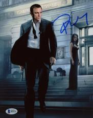 "Daniel Craig Autographed 8"" x 10"" Casino Royale Holding Gun Walking Away Photograph - Beckett COA"