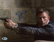 "Daniel Craig Autographed 8"" x 10"" Casino Royale Pointing Gun Photograph - Beckett COA"