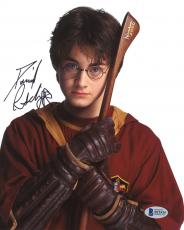 "Daniel Radcliffe Autographed 8"" x 10"" Harry Potter Hugging Broomstick Photograph - Beckett COA"