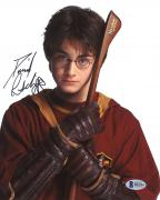 "Daniel Radcliffe Autographed 8"" x 10"" Harry Potter Hugging Broomstick Photograph - Beckett COA"