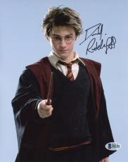 "Daniel Radcliffe Autographed 8"" x 10"" Harry Potter Pointing Wand Photograph - Beckett COA"