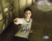"""Daniel Radcliffe Autographed 8""""x 10"""" Harry Potter and the Order of the Phoenix On Floor with Wand Photograph - Beckett COA"""