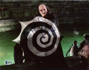 """Danny DeVito Autographed 8"""" x 10"""" Batman Returns Penguin Holding Umbrella Photograph - Beckett COA"""
