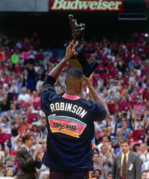 David Robinson San Antonio Spurs Unsigned Raising Up 1994-95 MVP Trophy Towards Crowd Photograph