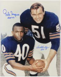 Dick Butkus & Gale Sayers Autographed 16'' x 20'' Posing with Blue Ink Photo with HOF Inscriptions - Mounted Memories