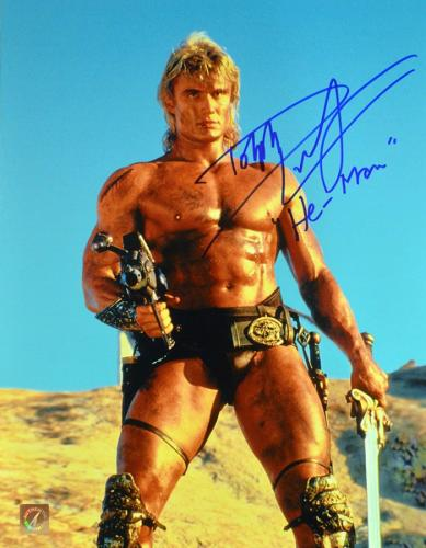 """Dolph Lundgren """"He-Man"""" Signed Masters Of The Universe 11x14 Photo """"Holding Gun"""