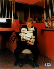 "Donald Trump Autographed 8"" x 10"" Sitting Holding Money Bundles Photograph - Beckett LOA"