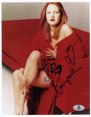 """Drew Barrymore Autographed 8""""x 10"""" Wearing Red Dress on Couch Photograph - Beckett COA"""