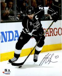 Dustin Brown Los Angeles Kings 2014 Stanley Cup Champions Autographed 16'' x 20'' Vertical Action Black Jersey Photograph - Mounted Memories
