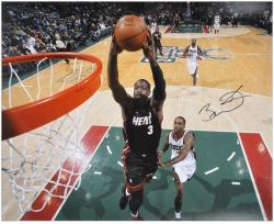 "Dwyane Wade Miami Heat Autographed 16"" x 20"" vs. Milwaukee Bucks Photograph"
