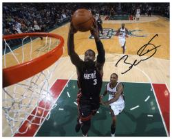 "Dwyane Wade Miami Heat Autographed 8"" x 10"" vs. Milwaukee Bucks Photograph - Mounted Memories"
