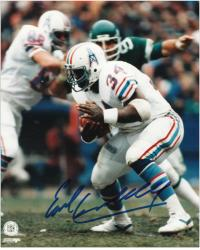 "Earl Campbell Houston Oilers Autographed 8"" x 10"" Ducking Photograph"