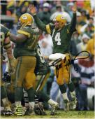 Brett Favre Green Bay Packers Autographed 8'' x 10'' Jumping Up Photograph - Mounted Memories