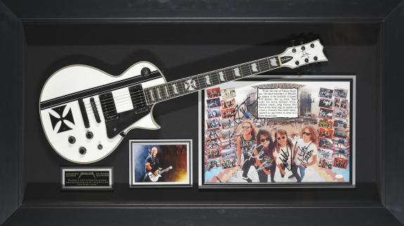 Features a signed band photograph signed by James Hetfield, Lars Ulrich, Kirk Hammett, and Jason Newsted and an Iron Cross guitar Framed 52x29x5