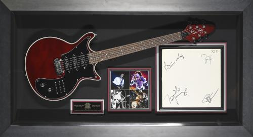 Features a signed XIV album flat by all four band members and a Brian May Guitar Framed 53x36x3