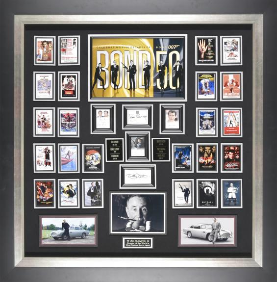 Features signatures from six James Bond characters - Sean Connery, George Lazenby, Roger Moore, Timothy Dalton, Pierce Brosnan, Daniel Craig, and photo of Creator Ian Fleming Framed 52×48