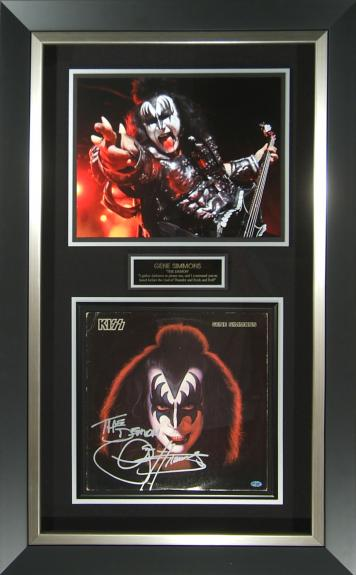 Features signed Gene Simmons solo album with additional concert photograph