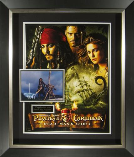 Features signed photograph from Johnny Depp as Capt. Jack Sparrow accompanied by the Dead Man's Chest movie poster