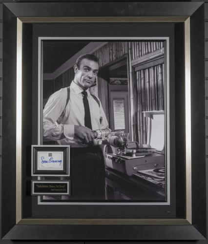 """Featuring a Sean Connery signature card framed with a black and white movie still from the famed movie James Bond Dr. No titled """"Vodka Martini, Shaken Not Stirred"""""""