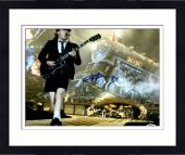 """Framed Angus Young Autographed 11"""" x 14""""  AC/DC Playing Guitar With Train In Background Photograph - PSA/DNA COA"""