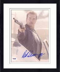 "Framed Arnold Schwarzenegger Autographed 8""x 10"" Terminator 2: Judgement Day Holding Gun Near Car Photograph - PSA/DNA COA"