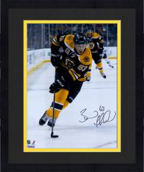 "Framed Brad Marchand Boston Bruins Autographed 16"" x 20"" Vertical Black Uniform Skating Photograph"