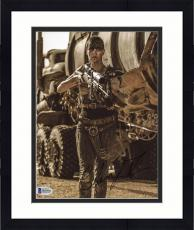 """Framed Charlize Theron Autographed 8"""" x 10"""" Mad Max Holding Gun Photograph - Beckett COA"""