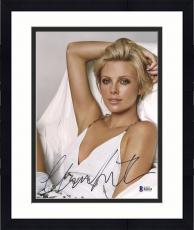 "Framed Charlize Theron Autographed 8"" x 10"" Posing with White Dress Photograph - Beckett COA"